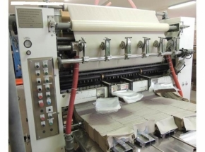 Facial folding and rewinding machine for towels and facial tissue